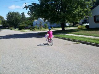 Grace riding her bike